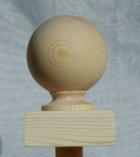 Ball newel cap in pine, on square base.